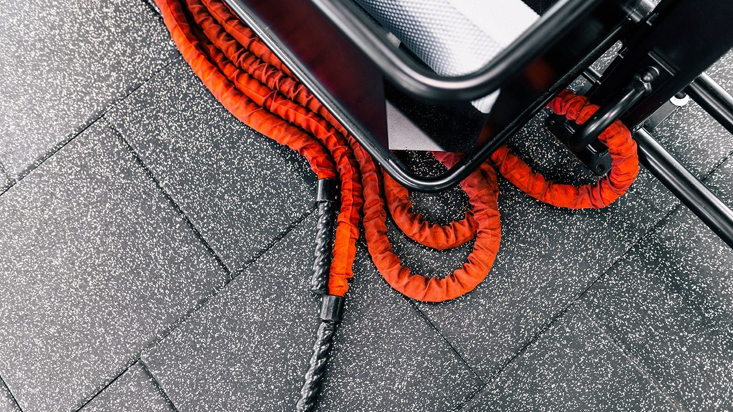 Origin Fitness impact flooring with battle rope