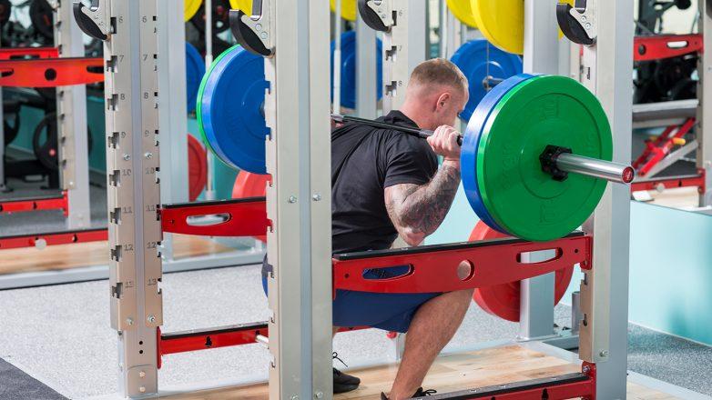 free weight barbell training origin